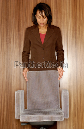 woman holding office chair