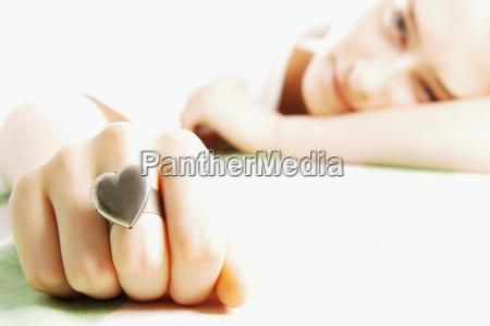 young woman wearing heart shaped ring