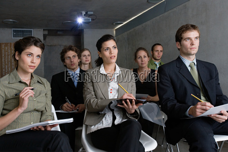people making notes in a presentation