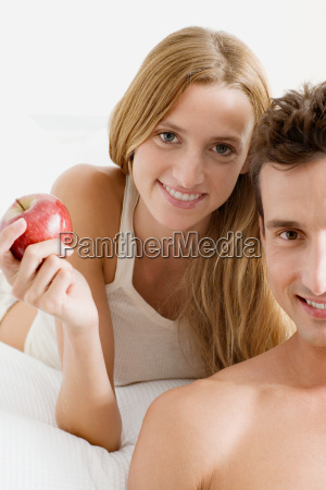 man and woman with apple