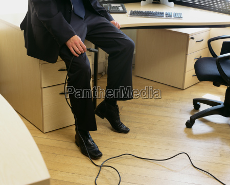 businessman holding a computer cable