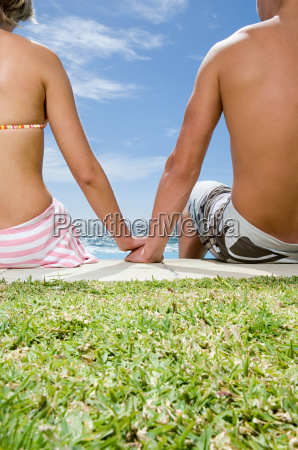 young couple holding hands by the
