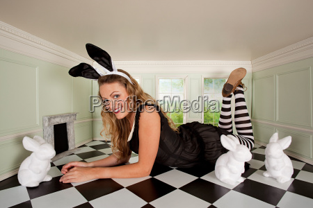 young woman in small room with