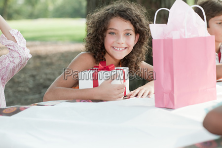 girl at birthday party with birthday