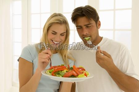couple eating salad