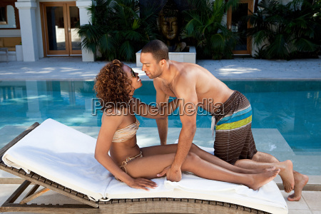 affectionate couple on sun lounger