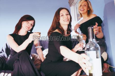 women, having, a, drink - 18747610