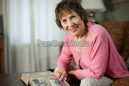 senior woman with family album