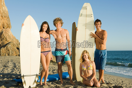 surfer friends at the beach