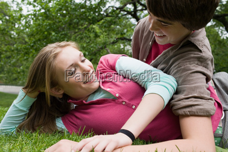 teenage couple relaxing in a park