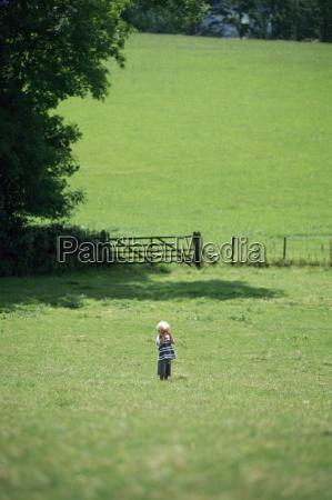 boy lost in a field