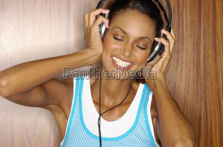 asian woman wearing headphones