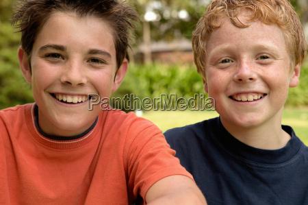 young boys smiling at camera