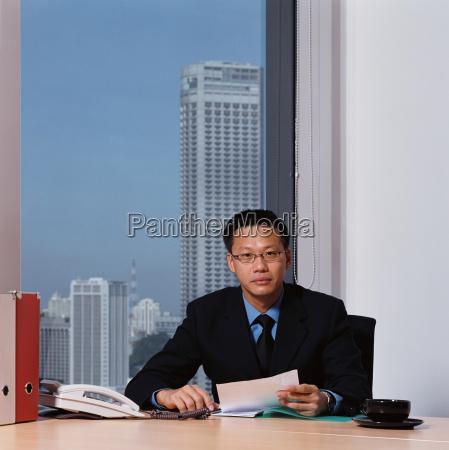 businessman holding a document