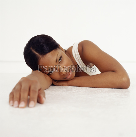 young woman lying down and reaching