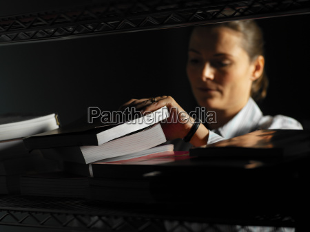 office worker looking through a stack