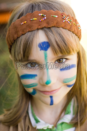 girl dressed in native american costume