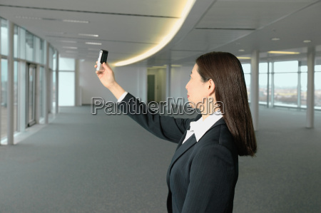 businesswoman using camera telephone