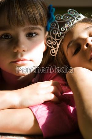 two girls one wearing tiara