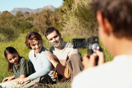 family posing for video camera