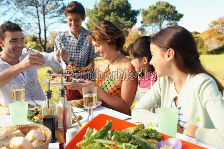 family eating in garden