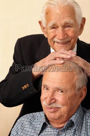 jovial portrait of two elderly men