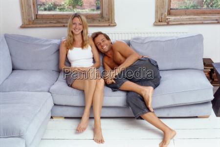 couple, sitting, together, on, sofa - 18753982