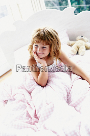 girl sitting in bed