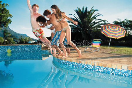 group jumping into pool