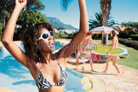 young woman dancing by pool