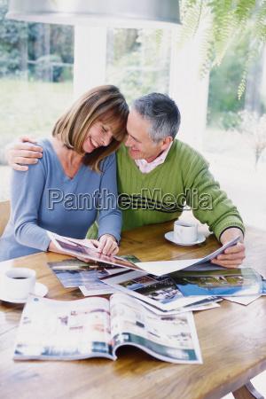 man and woman looking at photographs
