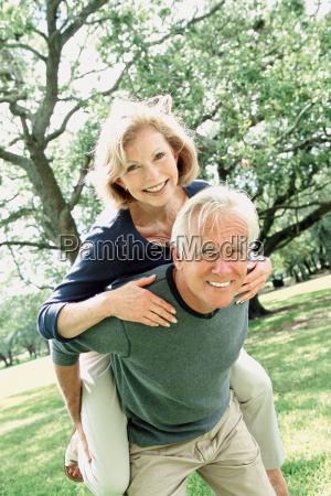 a senior couple fooling around