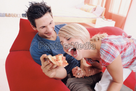 young couple eating together