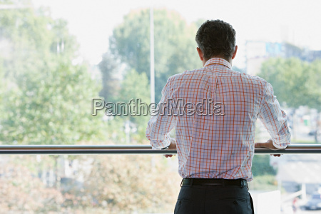 man looking out of the window