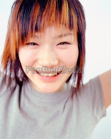 young oriental woman smiling