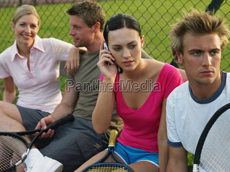young people at tennis court