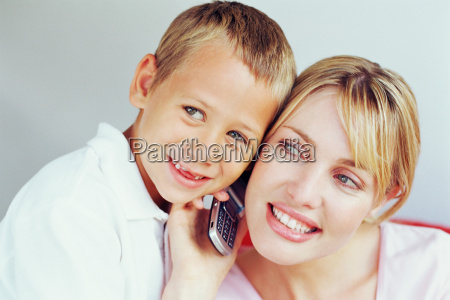 mother and son using mobile phone