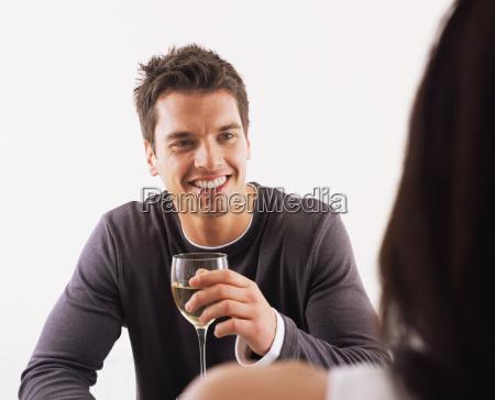 man and woman having wine