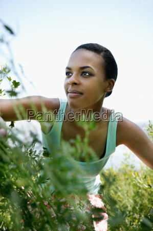 woman amongst plants