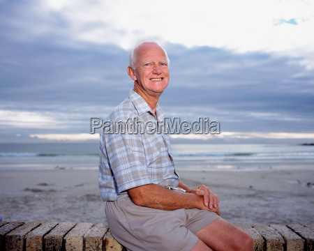 a mature man sitting by the