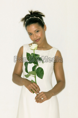 bride holding a white rose