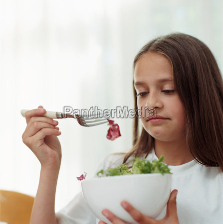 girl holding a bowl of salad