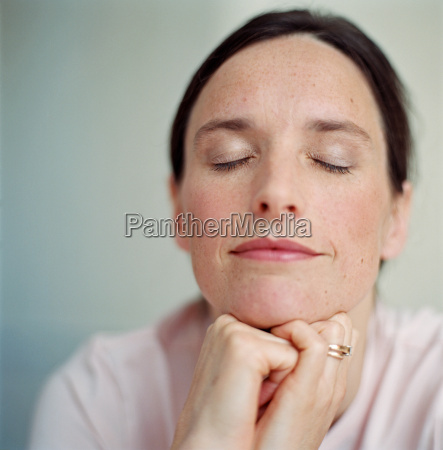 portrait of woman with eyes closed