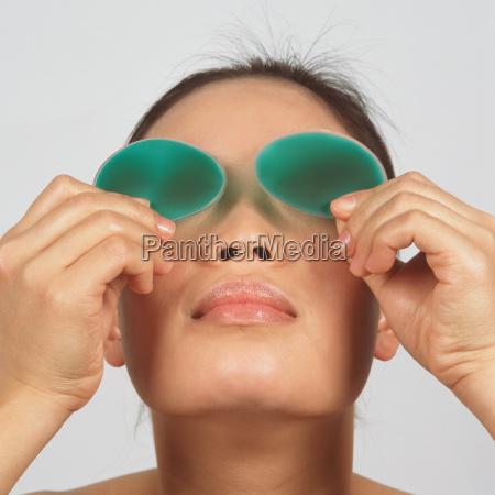 young woman wearing eye gel