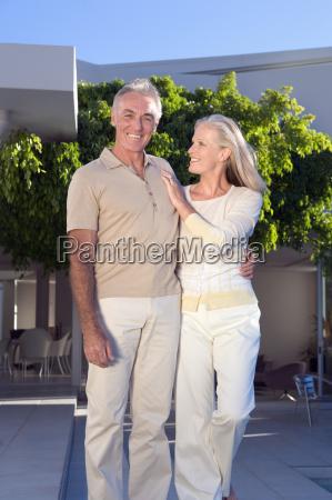mature couple outside house