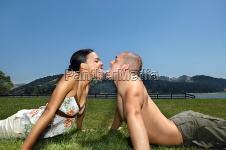 young couple touching tongues