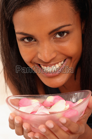 smiling young woman with bowl