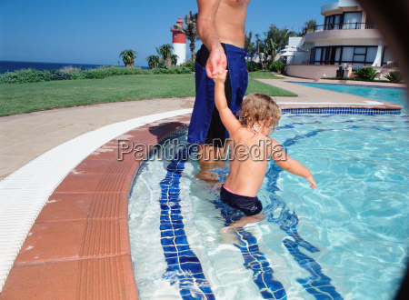 adult and child in pool