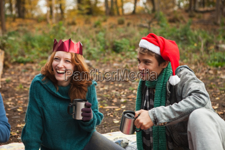 young couple wearing santa hats and