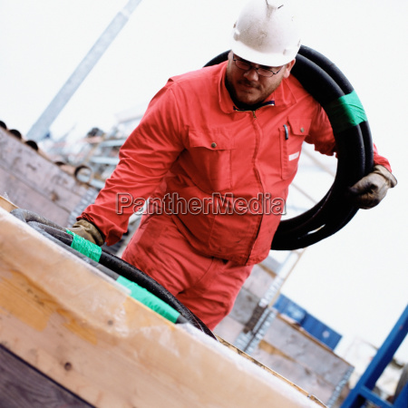 engineer holding pipe
